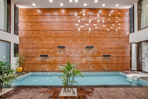 02.Exposed brick feature wall by the pool